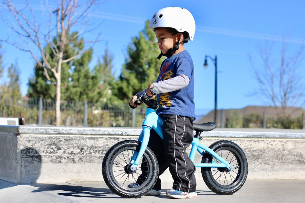young boy wearing a triple 8 helmet