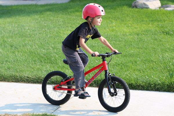 boy riding a red raleigh rowdy 16