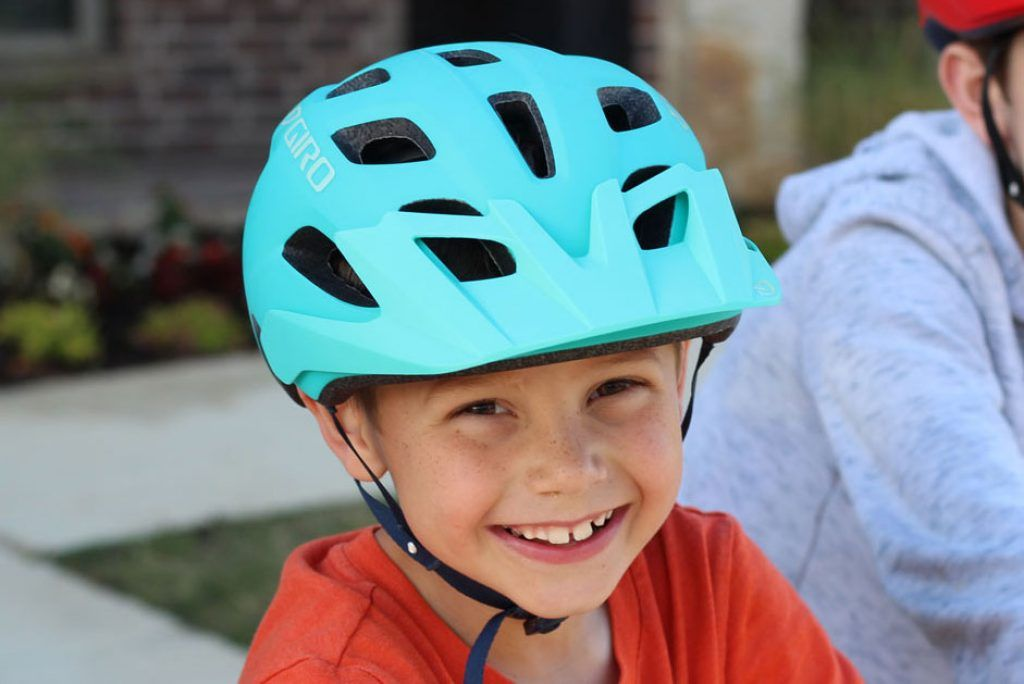 boy wearing a blue giro tremor bike helmet