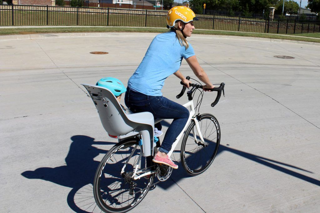 mom riding with a toddler in a thule ridealong lite child bike seat