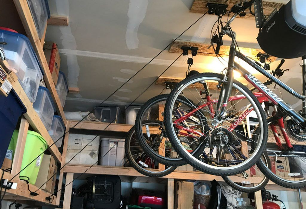 bikes mounted on the ceiling of a garage using the racor bike pulley