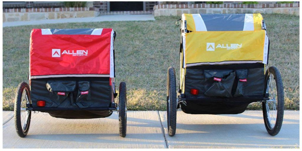 red and yellow allen sports bike trailers sitting side by side
