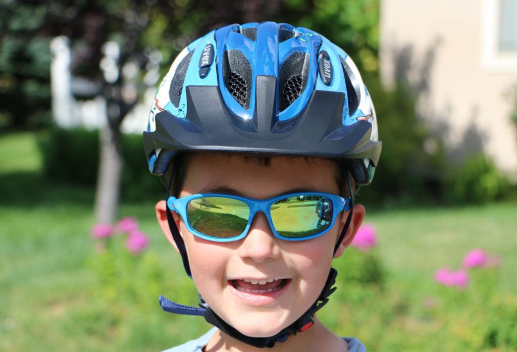 boy wearing a blue Uvex hero bike helmet