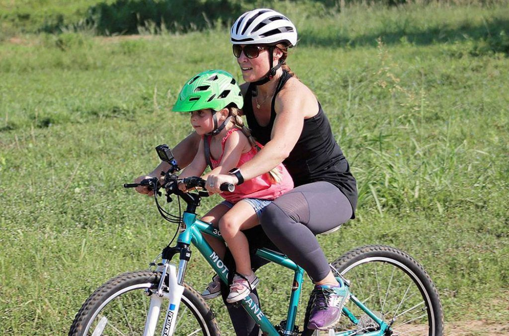 mother riding with her daughter on a do little mountain bike child bike seat