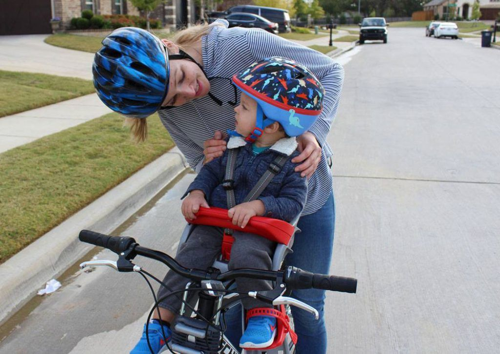 toddler riding in the Peg Pergo Orion child bike seat with mom watching