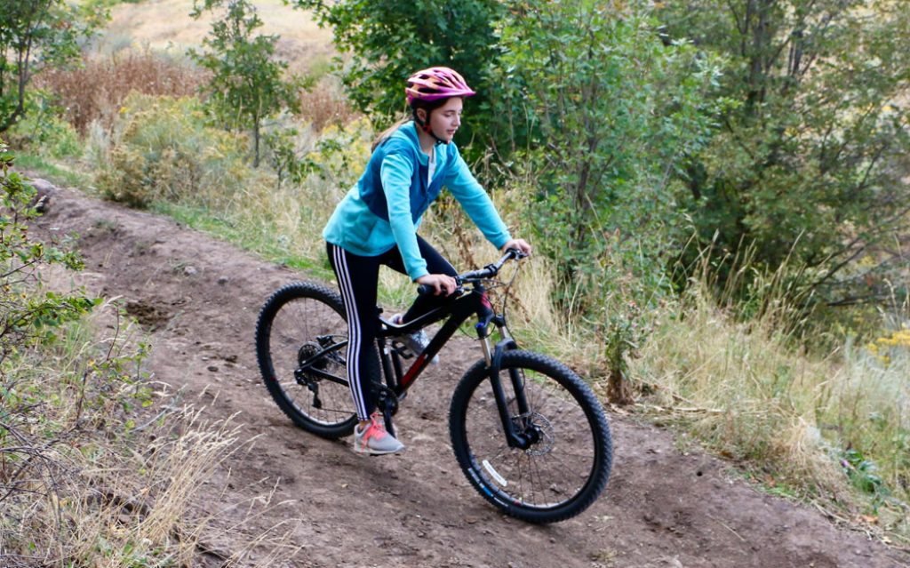 12 year old girl riding Diamondback Lux 3 mountain bike