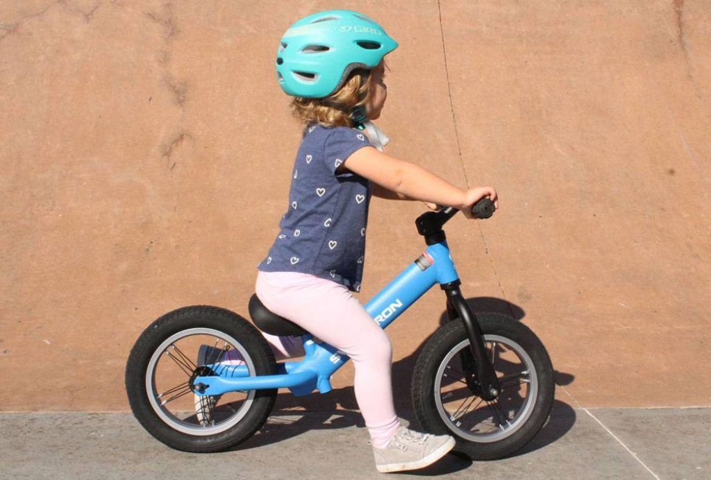 toddler riding the Swagtron k3 balance bike