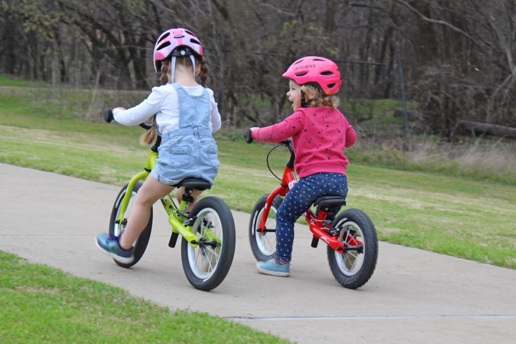 girls riding the scoot and scoot xl balance bike