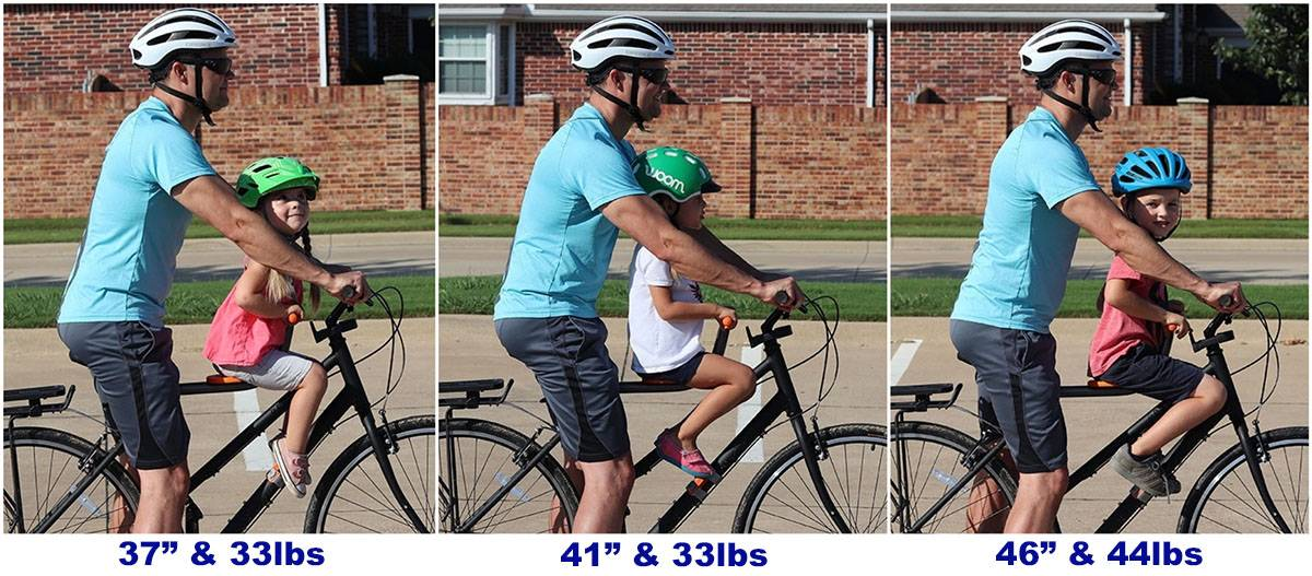 Side by side sizing comparison of 3, 4, and 6 year old rider on the Tyke Toter with dad