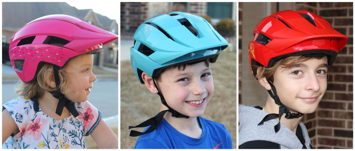 Side by side comparison of kids wearing the three sizes of the Bell Sidetrack 2 kids helmet.