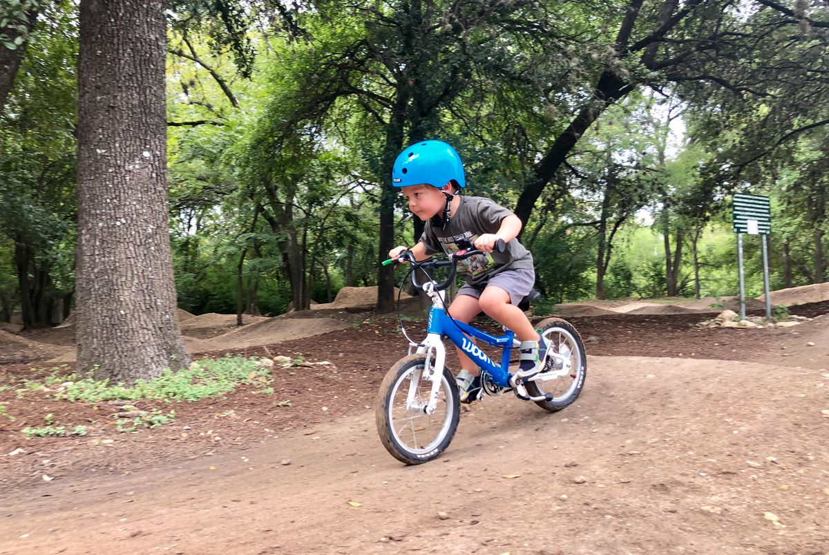 4-year-old riding woom 2 in 9th St. BMX park in Austin, TX