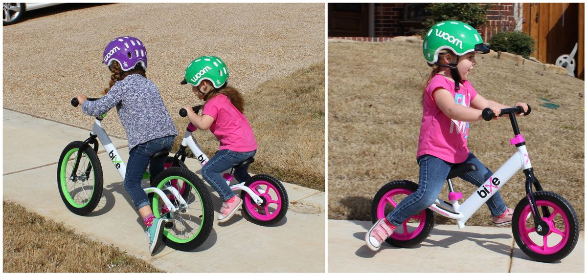 Two sisters racing on Bixe 16 and Bixe 12 balance bikes