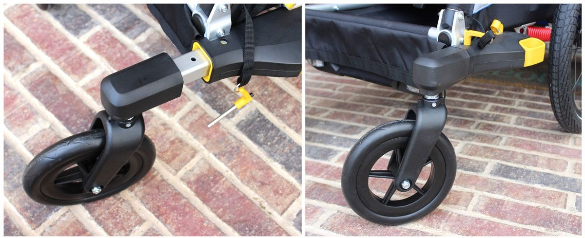 Burley D'Lite double stroller wheel being inserted into quick receiver