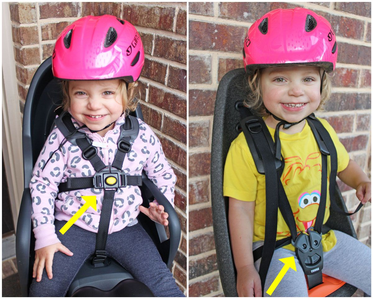 Burley Dash child bike seat buckle placement is high on the chest compared to other seats with the buckle in the crotch