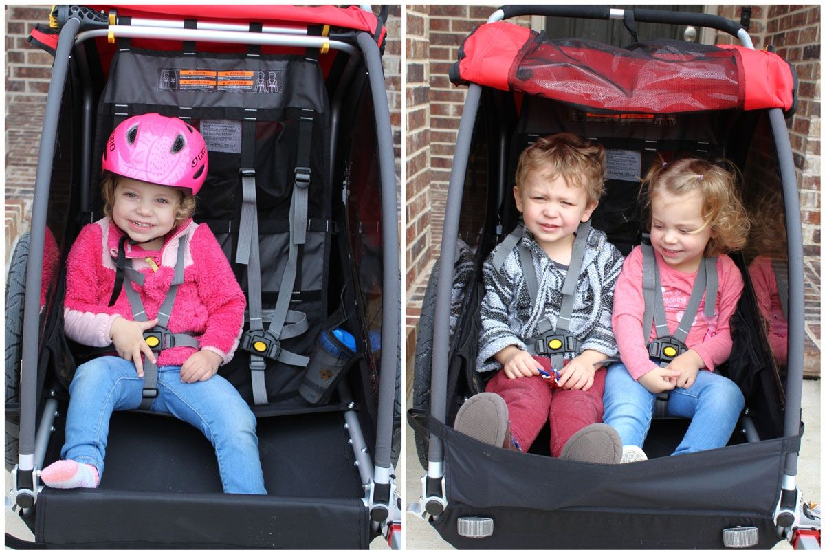 Side by side comparison of one child vs two children in the Burley Honey Bee bike trailer. Two 2 year olds is snug, but comfortable enough.