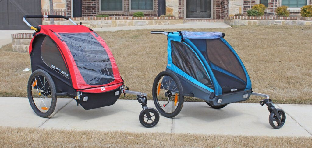 the burley honey bee next to the thule cadence kids bike trailer