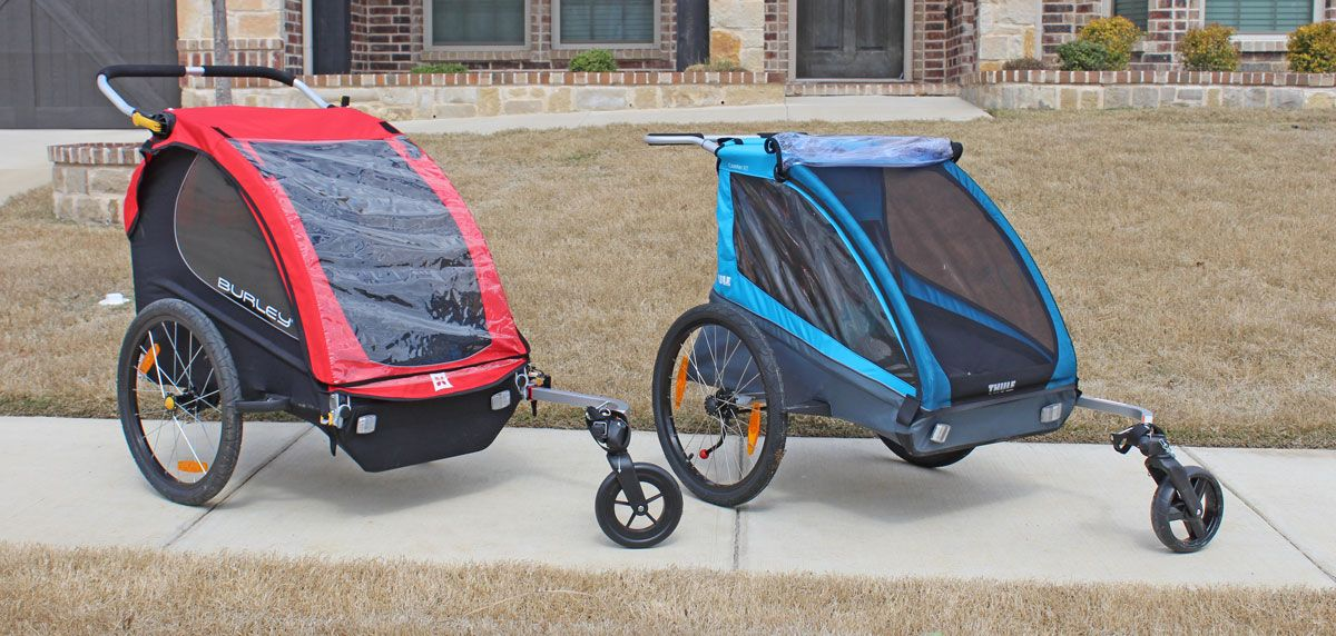 Burley Honey Bee and Thule Coaster XT bike trailers isde by side.