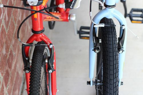 "Side by side comparison of tire width of Islabikes CNOC 20"" and Cleary Owl. The Owl's tires are over 0.5"" thicker."