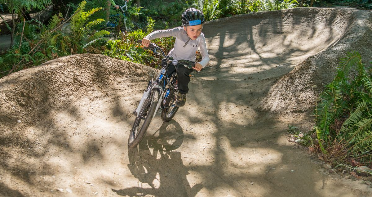 8-year-old boy riding mountain trail at Griffin Bike Park