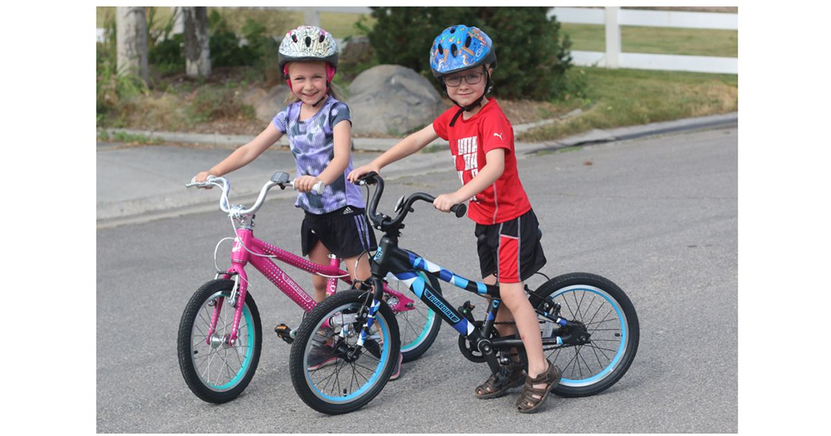 "5-year-old Boy and Girl on 16"" Guardian kids' bikes - pink and blue"