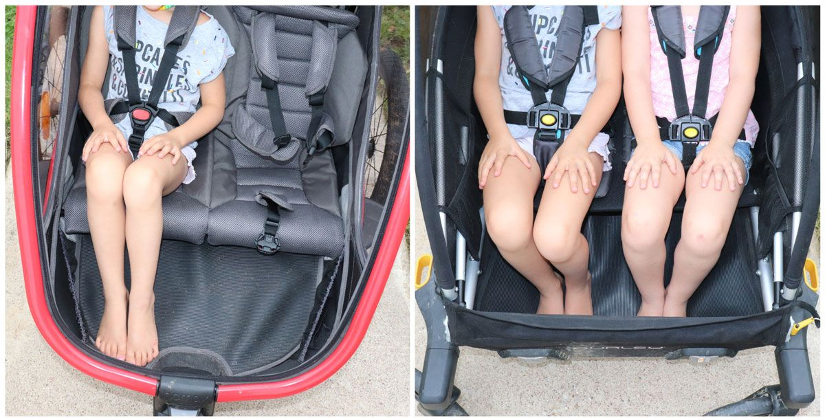 side by side comparison of legroom in Hamax Outback vs Burley D'Lite trailers. The Hamax has less legroom.