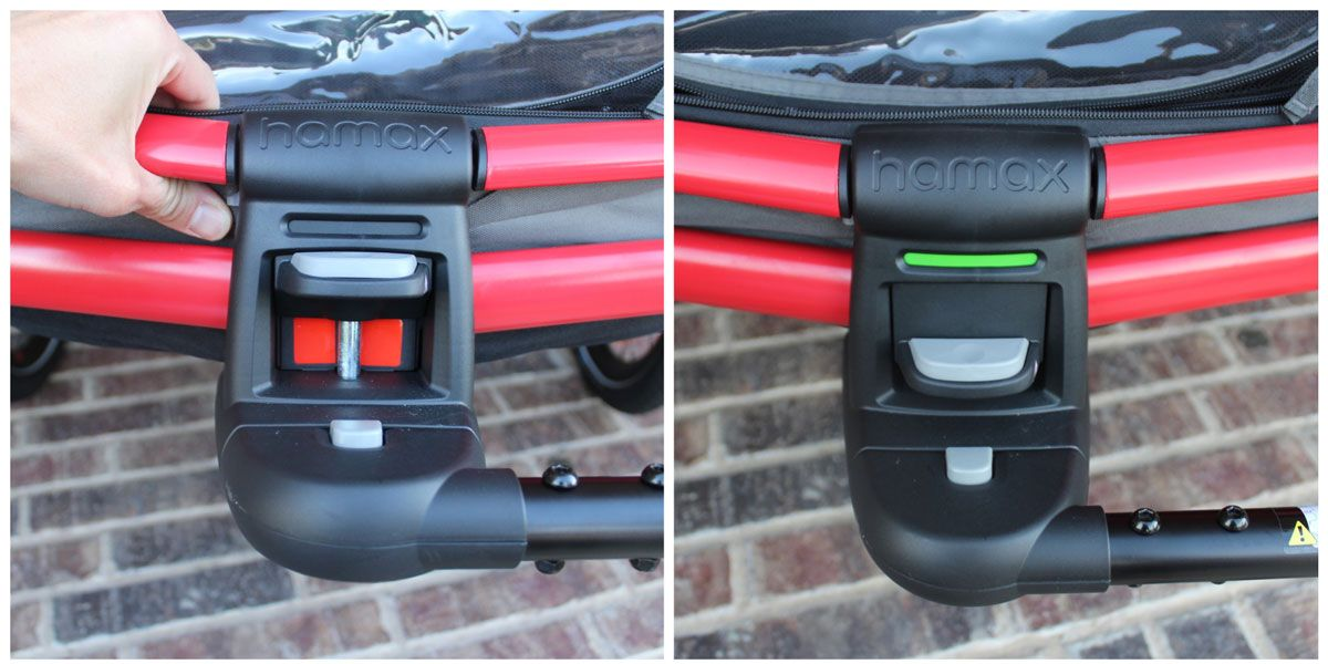 Tow arm attachment on the Hamax Outback showing red (not locked) and green (locked)