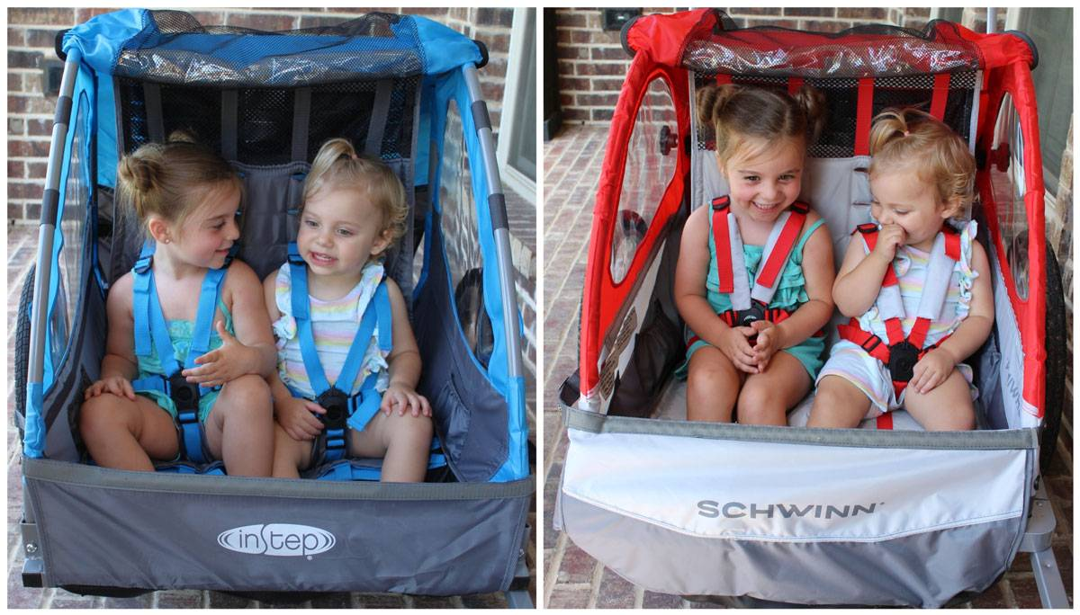 Side by side shots of 3 year old and 18 month old sitting in an InStep and the Schwinn Trailblazer trailers