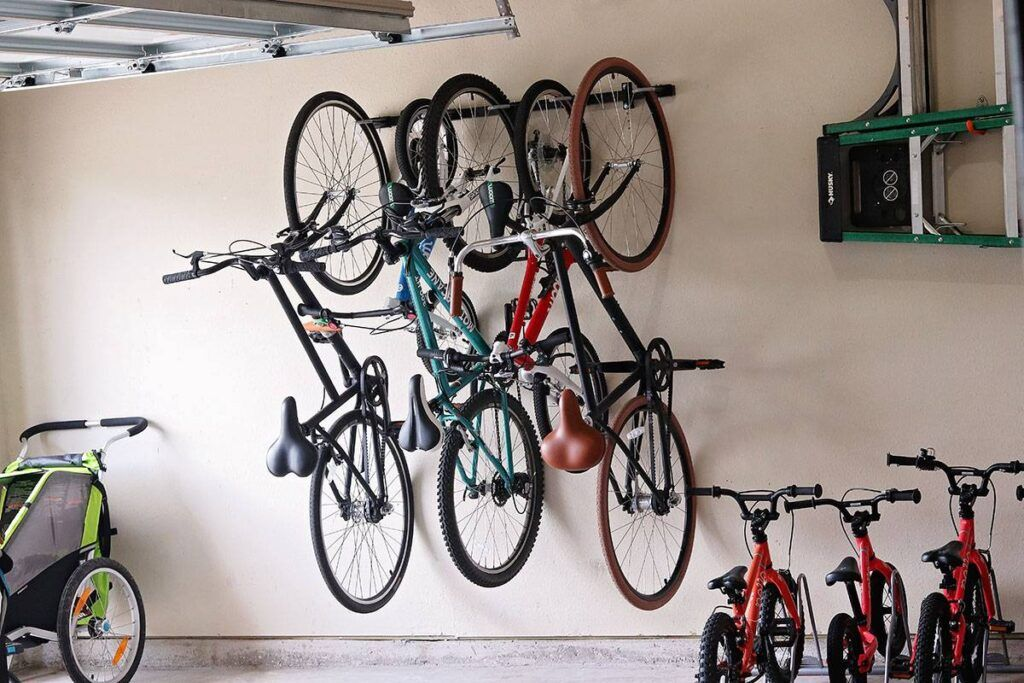 Omni wall mounted bike rack on the garage wall and loaded with five bikes