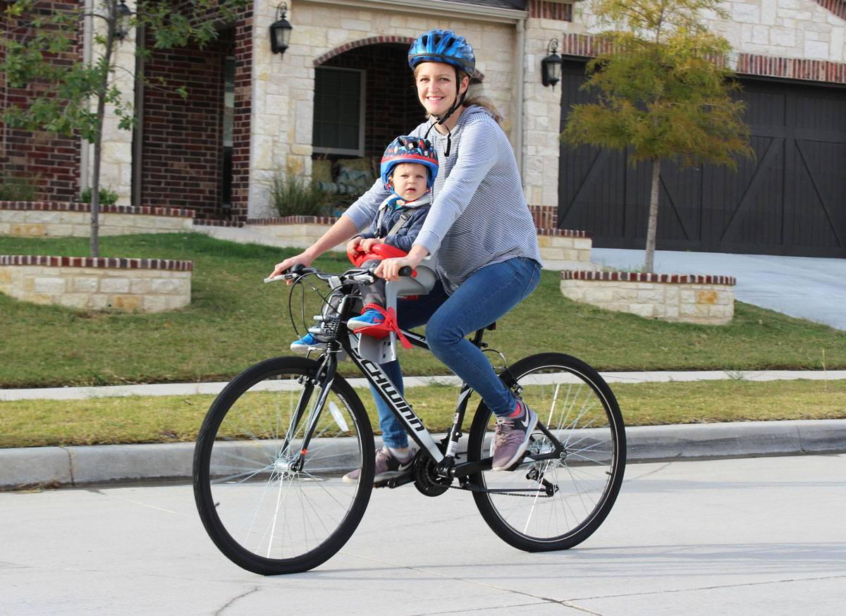 Mom riding with 15-month-old boy in Peg Perego Orion child bike seat