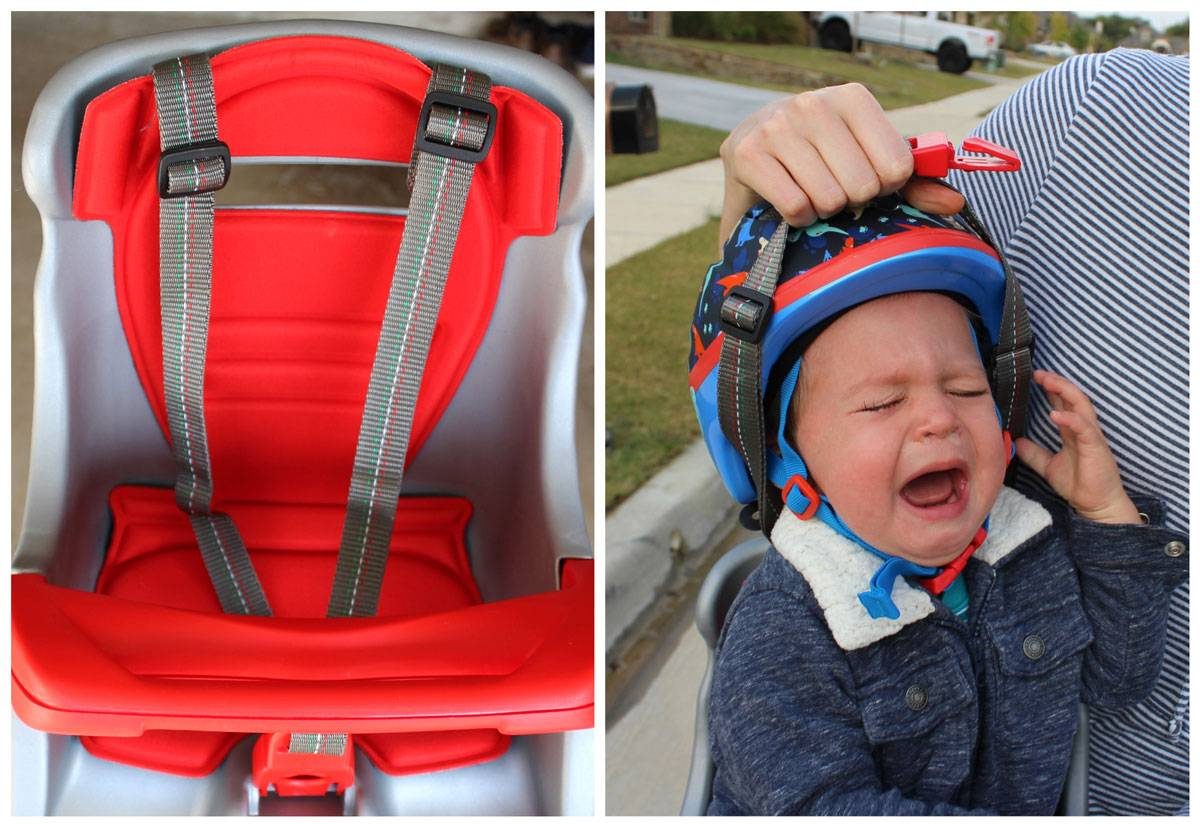 Shoulder straps being pulled over the helmet of a screaming baby in the Peg Perego Orion child bike seat