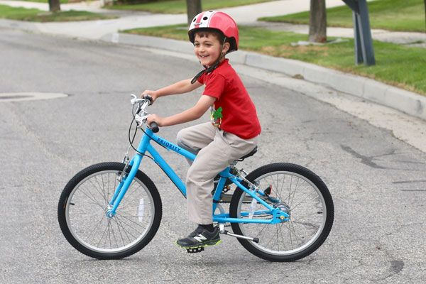 6 year old riding a Priority Start 20 inch kids bike