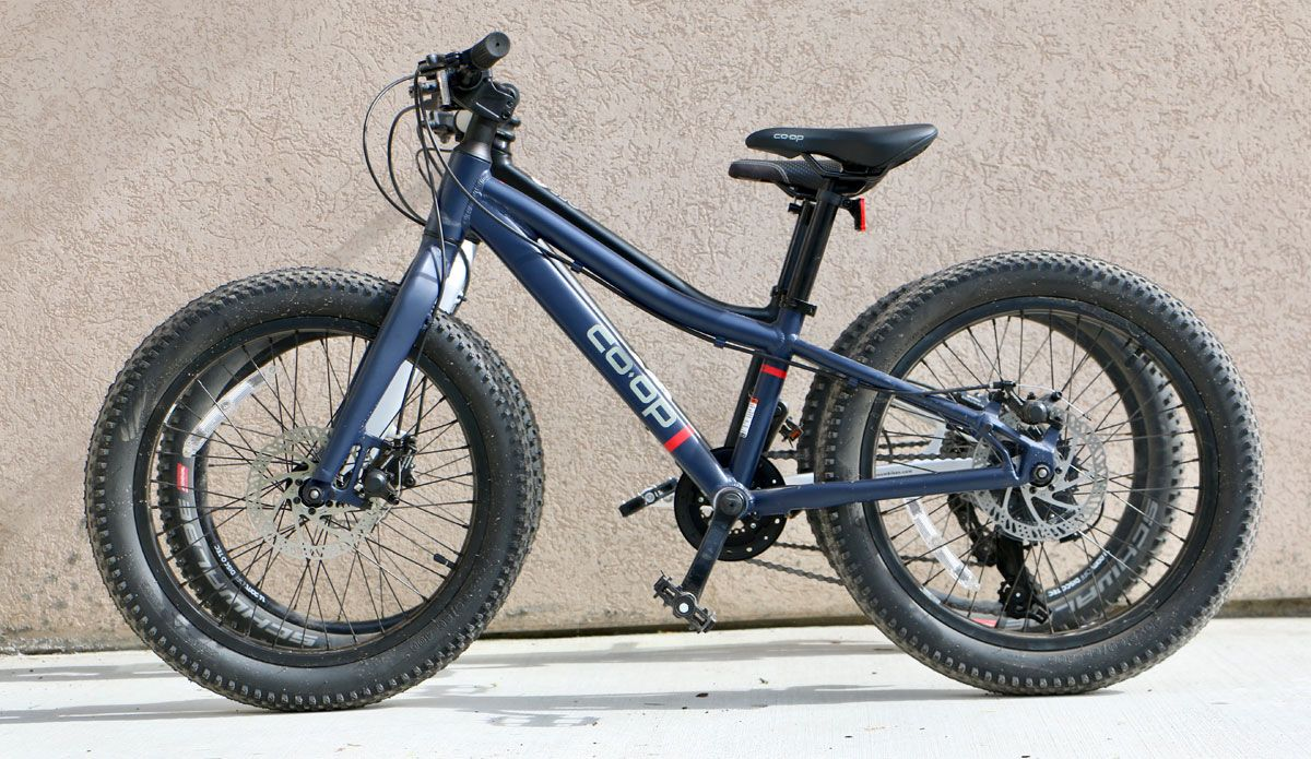 Side by side comparison of REI Kids Bikes Co-Op REV Plus 20geared bike and high-end woom 4 OFF mountain bike. Almost identical geometry.
