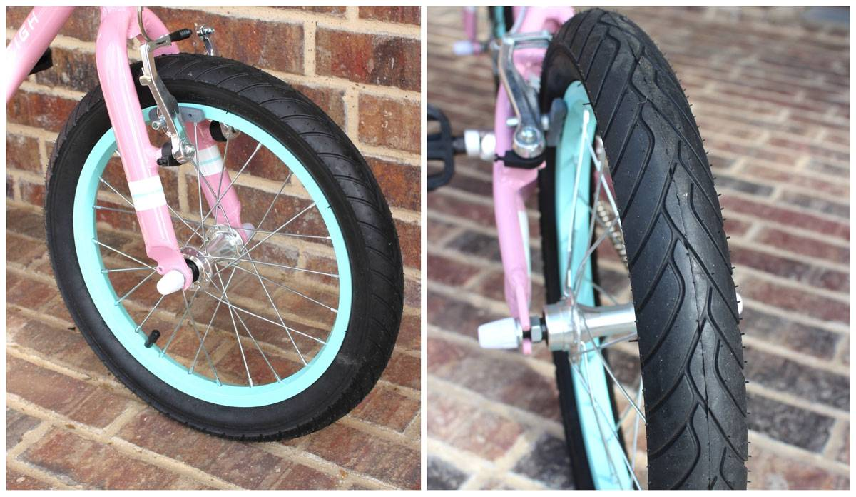 "Raleigh Lily 16"" wheels with aqua rims and street tire tread"