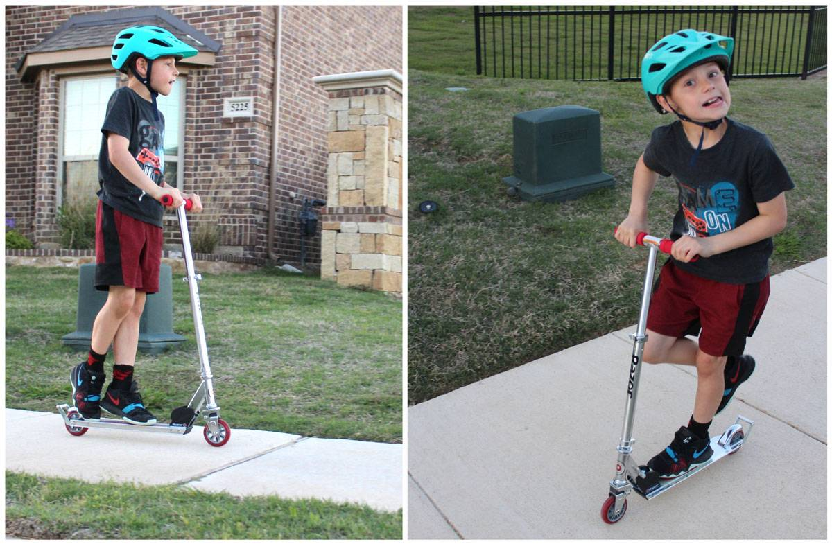 8-year-old boy riding the Razor A2 kick scooter in his neighborhood