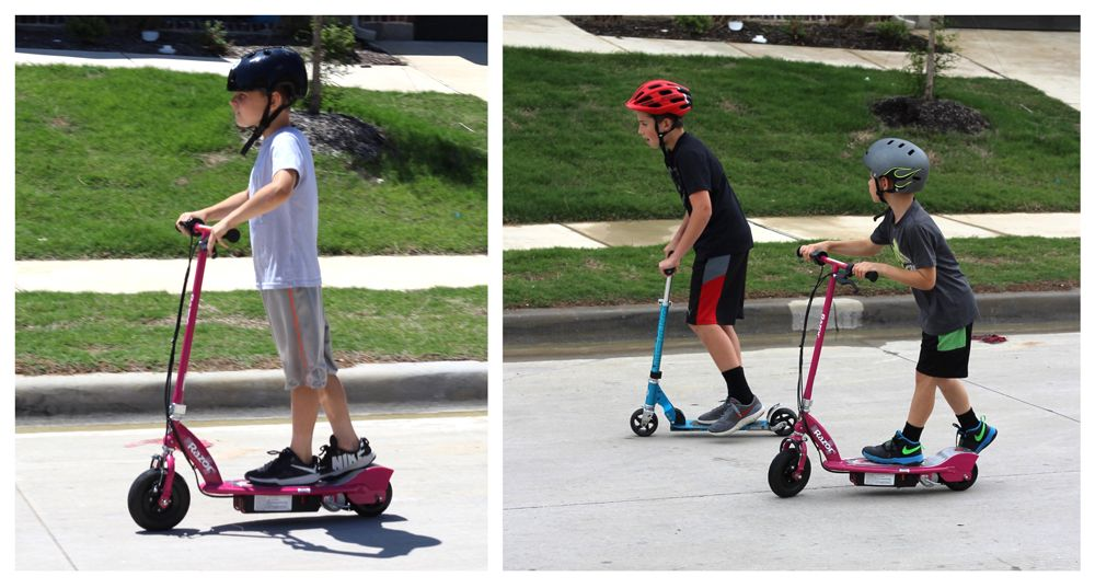 Boy racing his Razor E100 electric scooter against his friend on a traditional kick scooter.