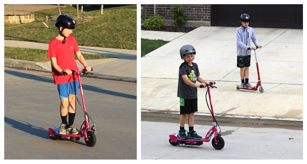 Boy riding his Razor E100 electric scooter with his brother on a traditional kick scooter.