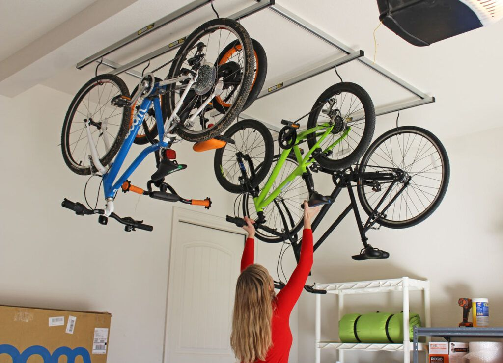 Saris cycle glide ceiling bike storage with four bikes hanging upside down