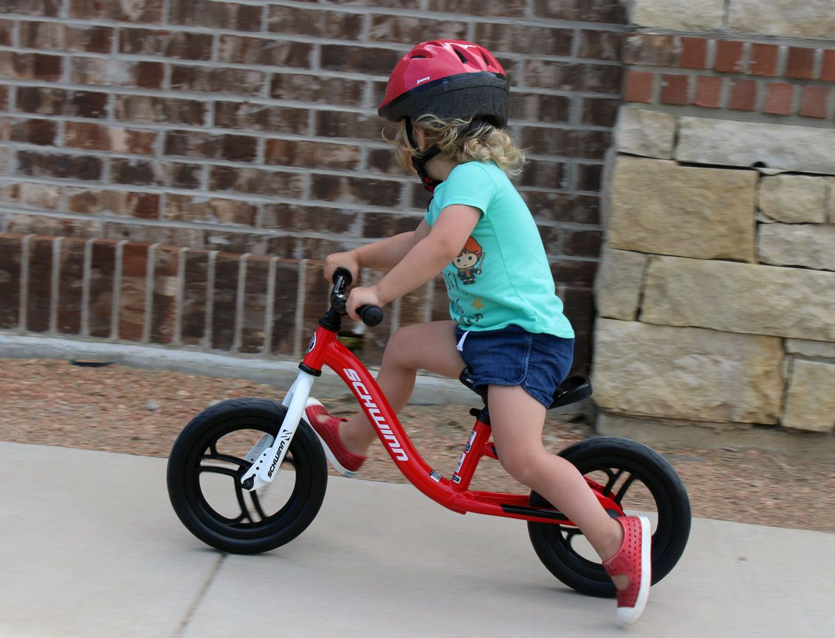 Schwinn Koen balance bike ridden by a 2 year old down the sidewalk