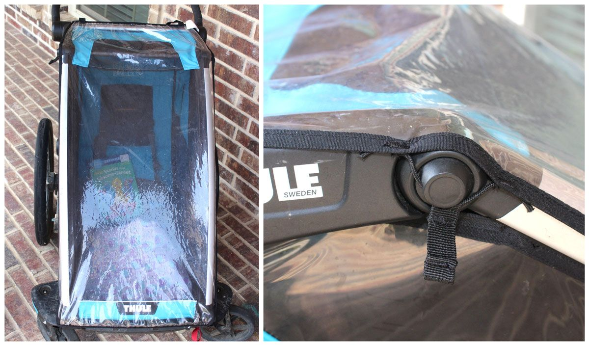 Thule Chariot Cross rain cover pulled tight over front of trailer