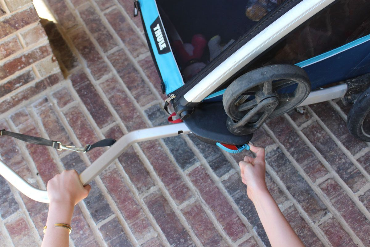 Inserting trailer tow arm into Thule Chariot Cross trailer