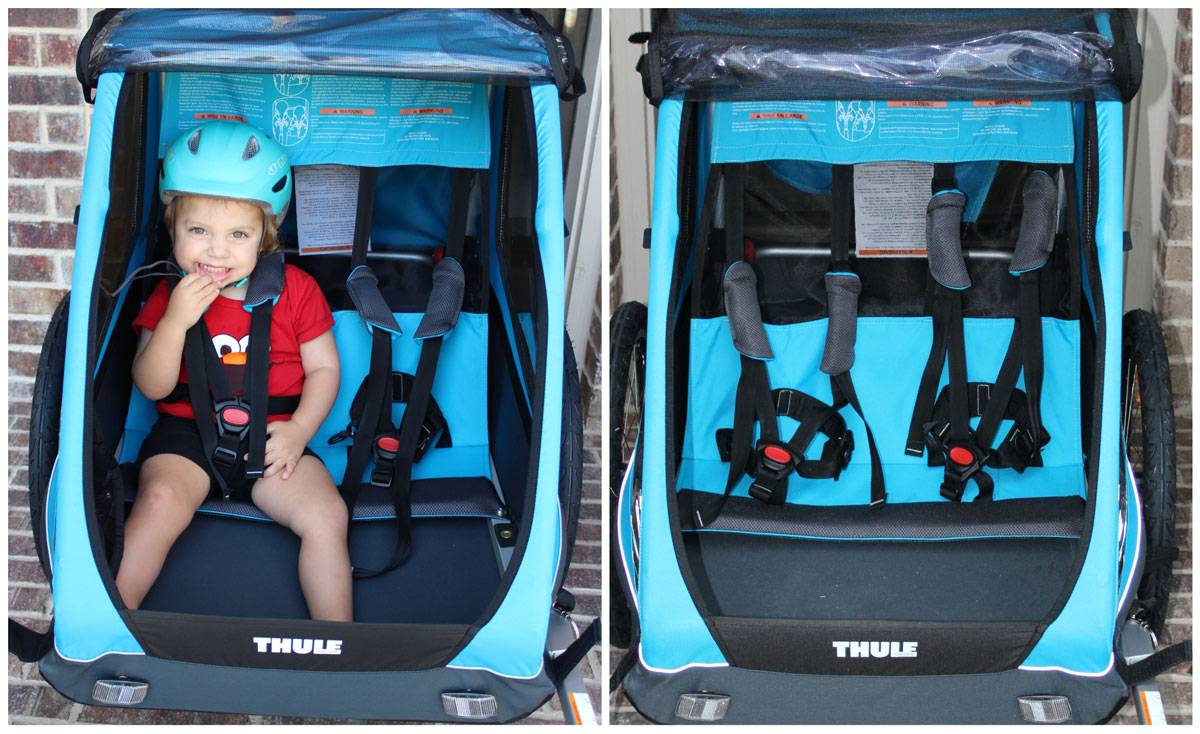 Thule Coaster XT bike trailer interior of the trailer showing seats, bottom and harnesses.
