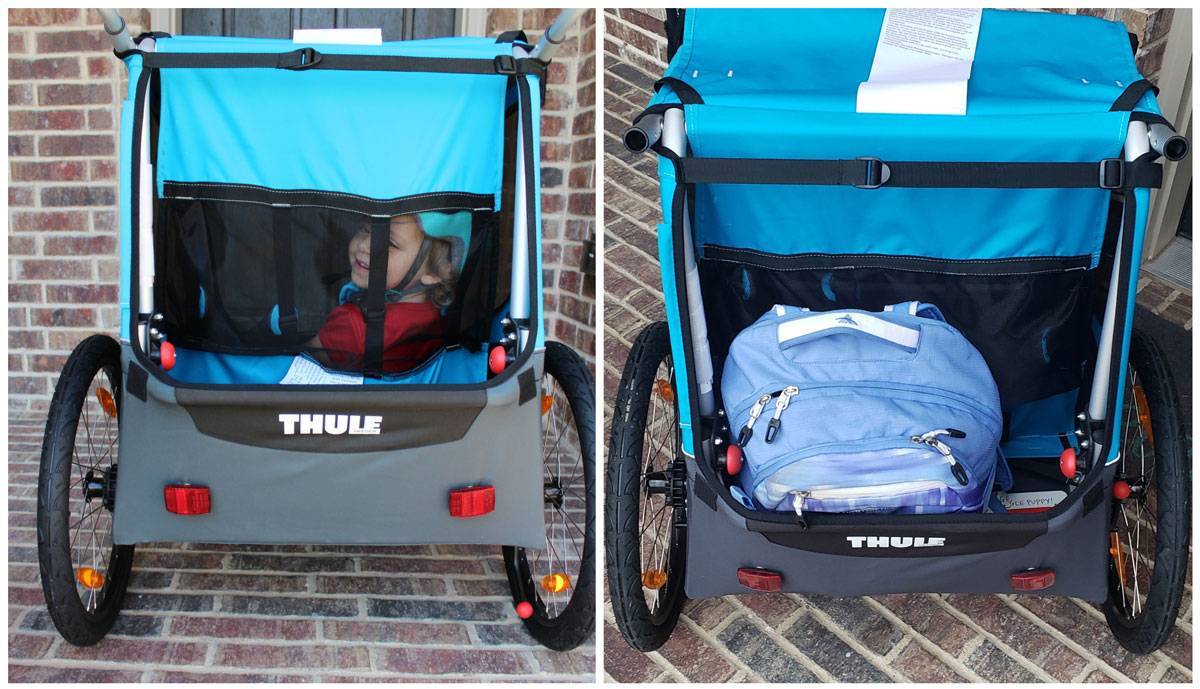 Thule Coaster XT bike trailer has great rear ventilation. Also shows backpack in the rear storage area.