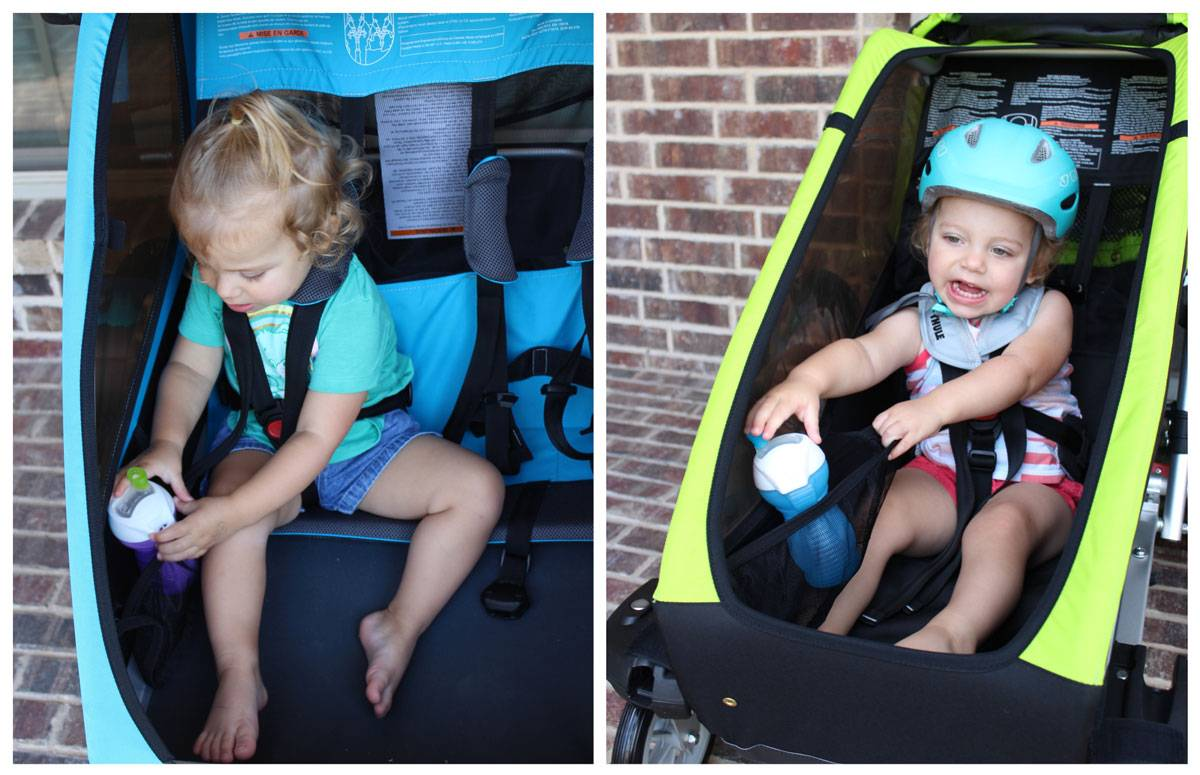 Side by side comparison of placement of the snack holder in the Thule Coaster XT and the Thule Chariot Cheetah XT. The Coaster's is closer to the child and much easier to access.