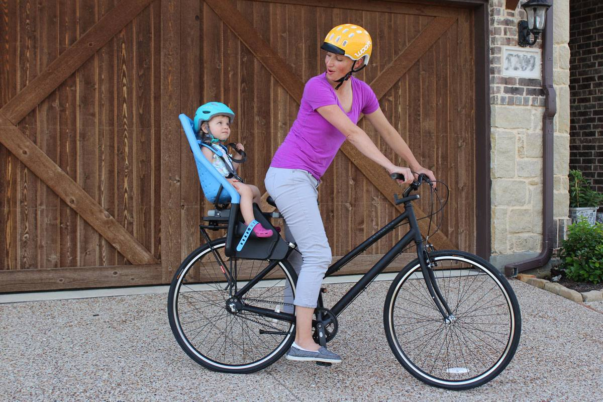 Mom riding with toddler in Thule Yepp Maxi child bike seat