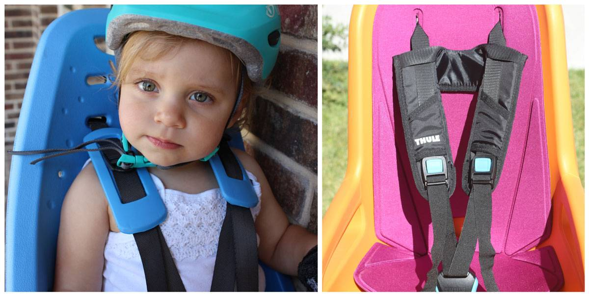 Soft foam shoulder strap pads on Thule Yepp Maxi child bike seat vs. backpack style straps on Thule RideAlong child bike seat