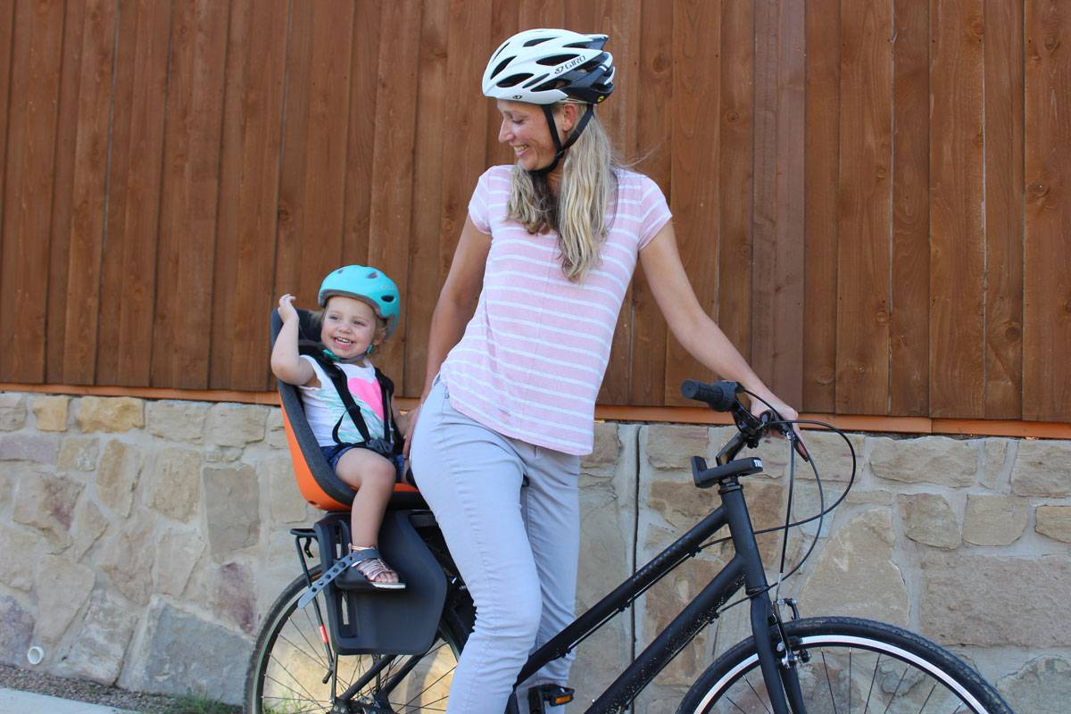 Mom smiling with toddler in Thule Yepp Next Maxi child bike seat