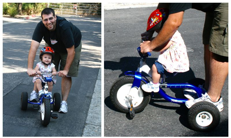 Dad trying to help 2-year-old daughter ride tricycle that is clearly too large for her.