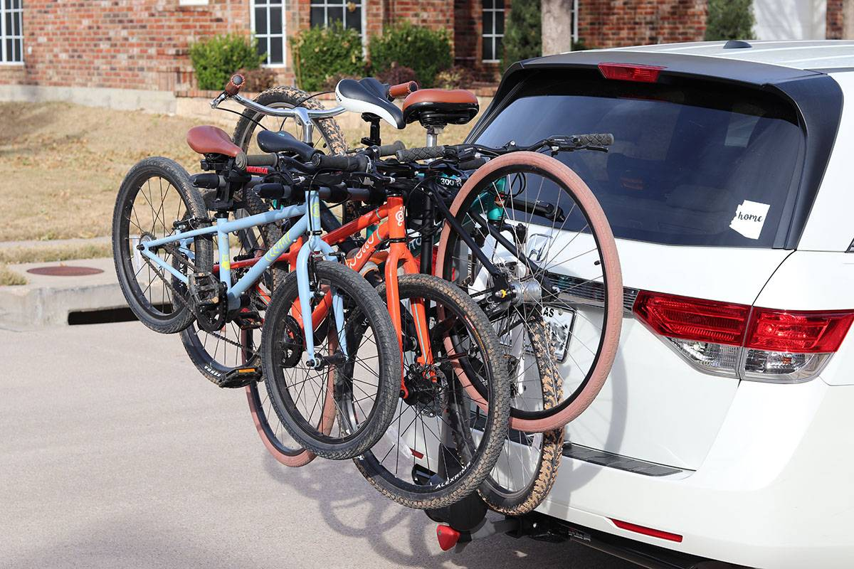 Yakima Ridgeback Hanging Hitch 5-Bike Rack loaded up with 4 bikes - 2 adult bikes and 2 kids bikes