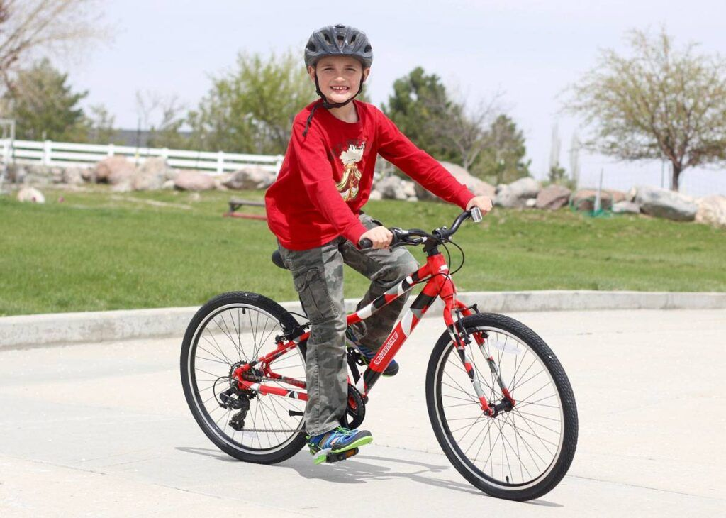 10 year old riding the Guardian Original 24 inch kids bikes