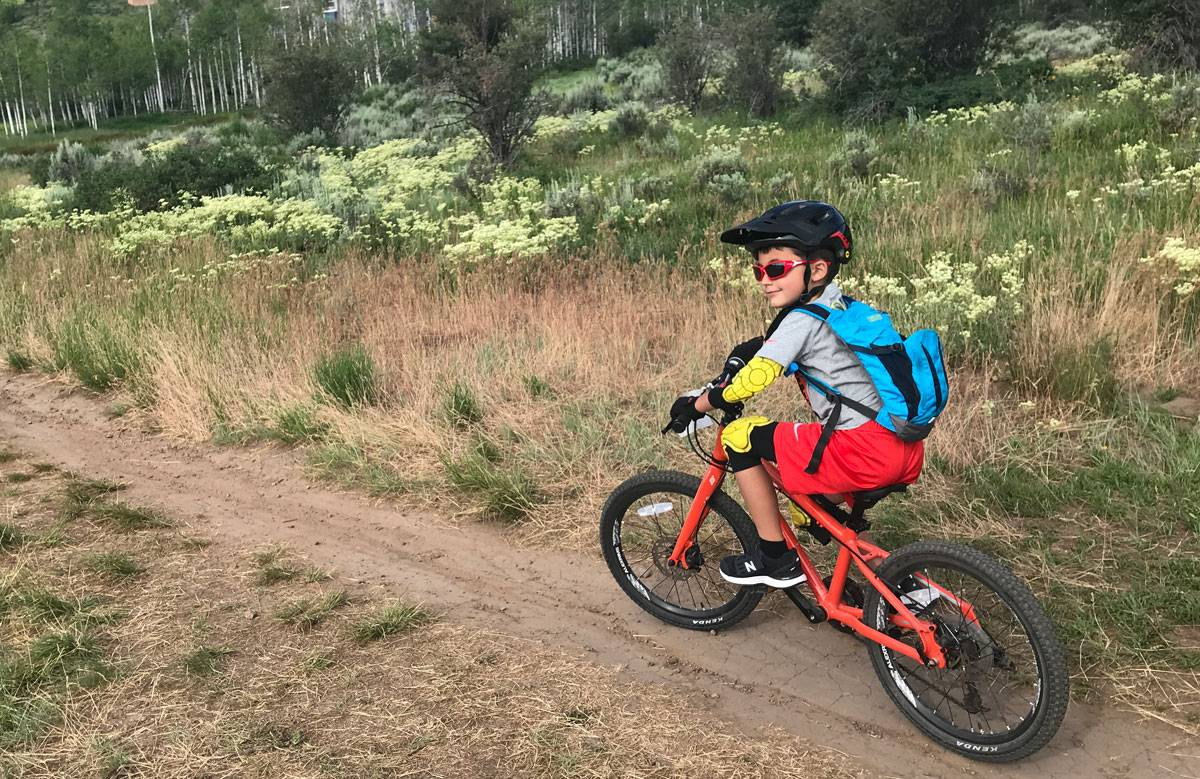 7-year-old boy riding the Pello Rover on a dirt mountain bike trail
